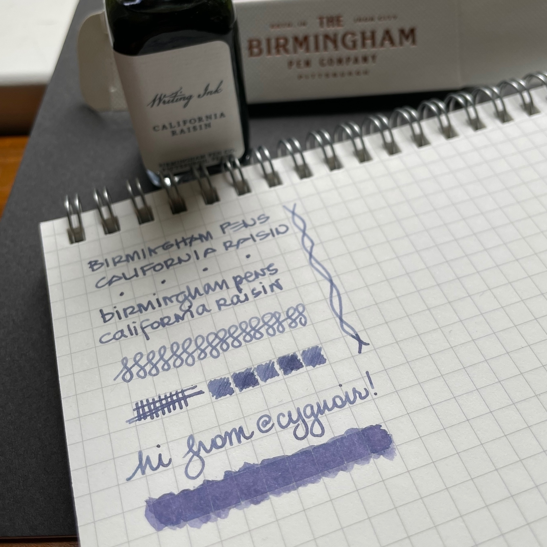 sample writing in faded blue fountain pen ink