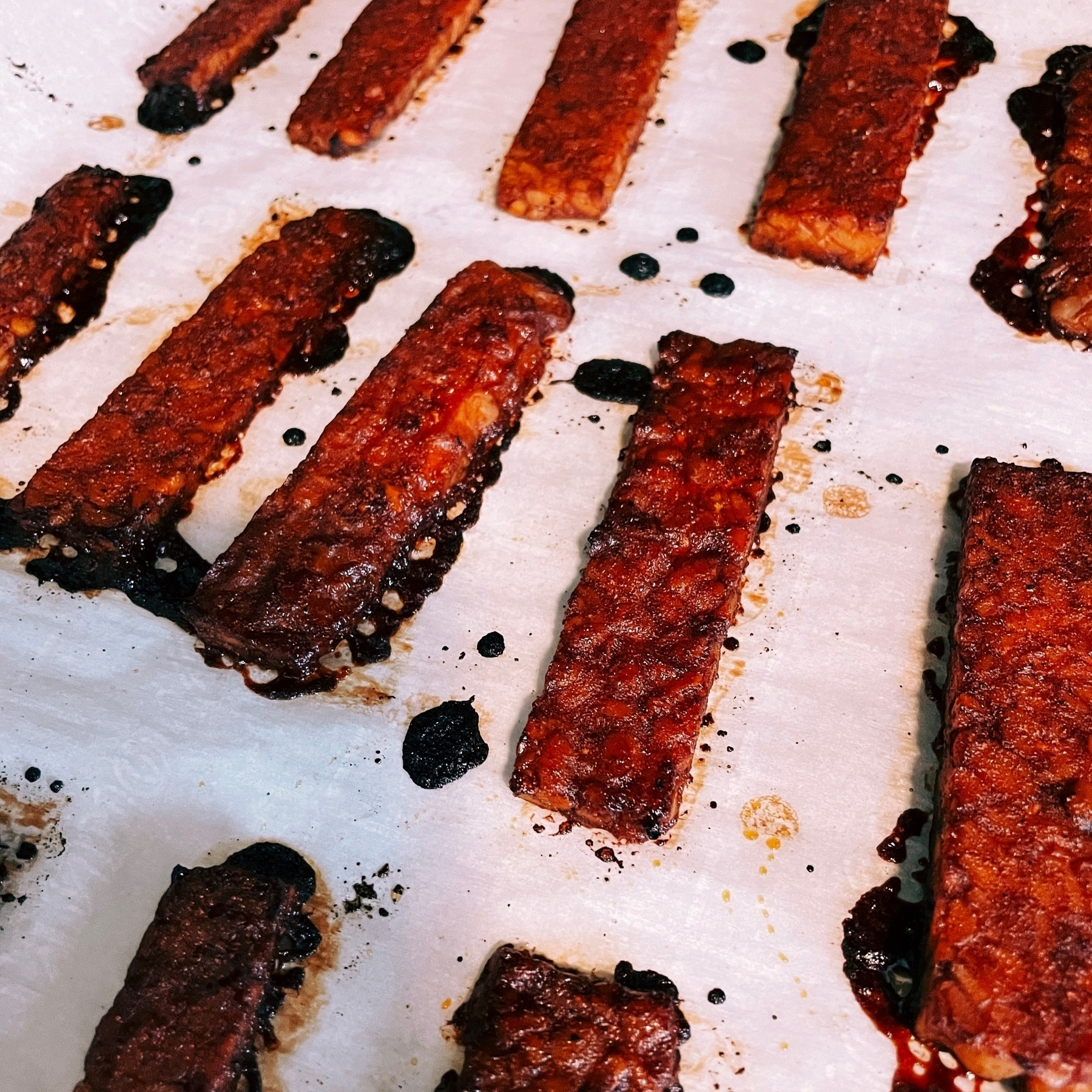 slices of vegan bacon on parchment paper